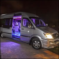 Outside view of bus with LED lighting on display
